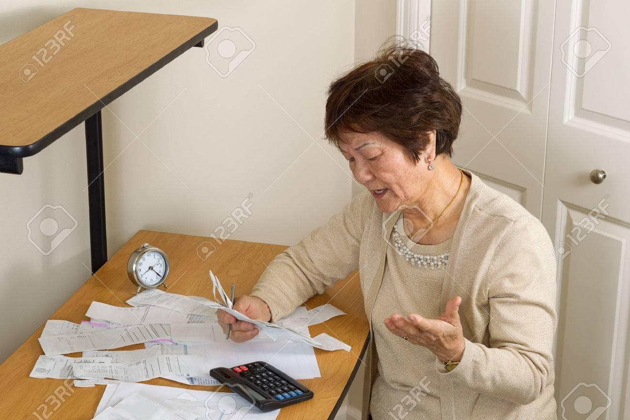 Senior woman upset at her bills. In debt concept. - 50226964