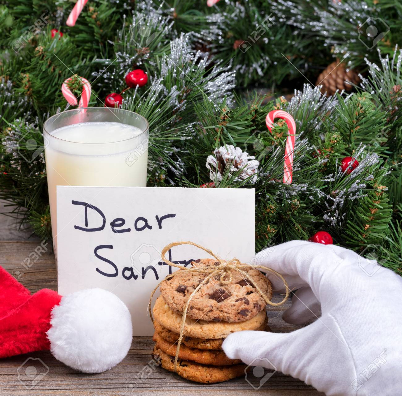 Stack Of Fresh Cookies Glass Of Milk And Letter For Santa With