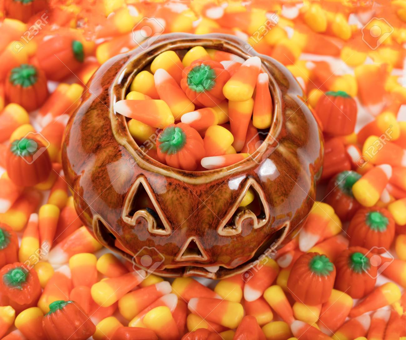 halloween candy treats in pumpkin container stock photo 85703342