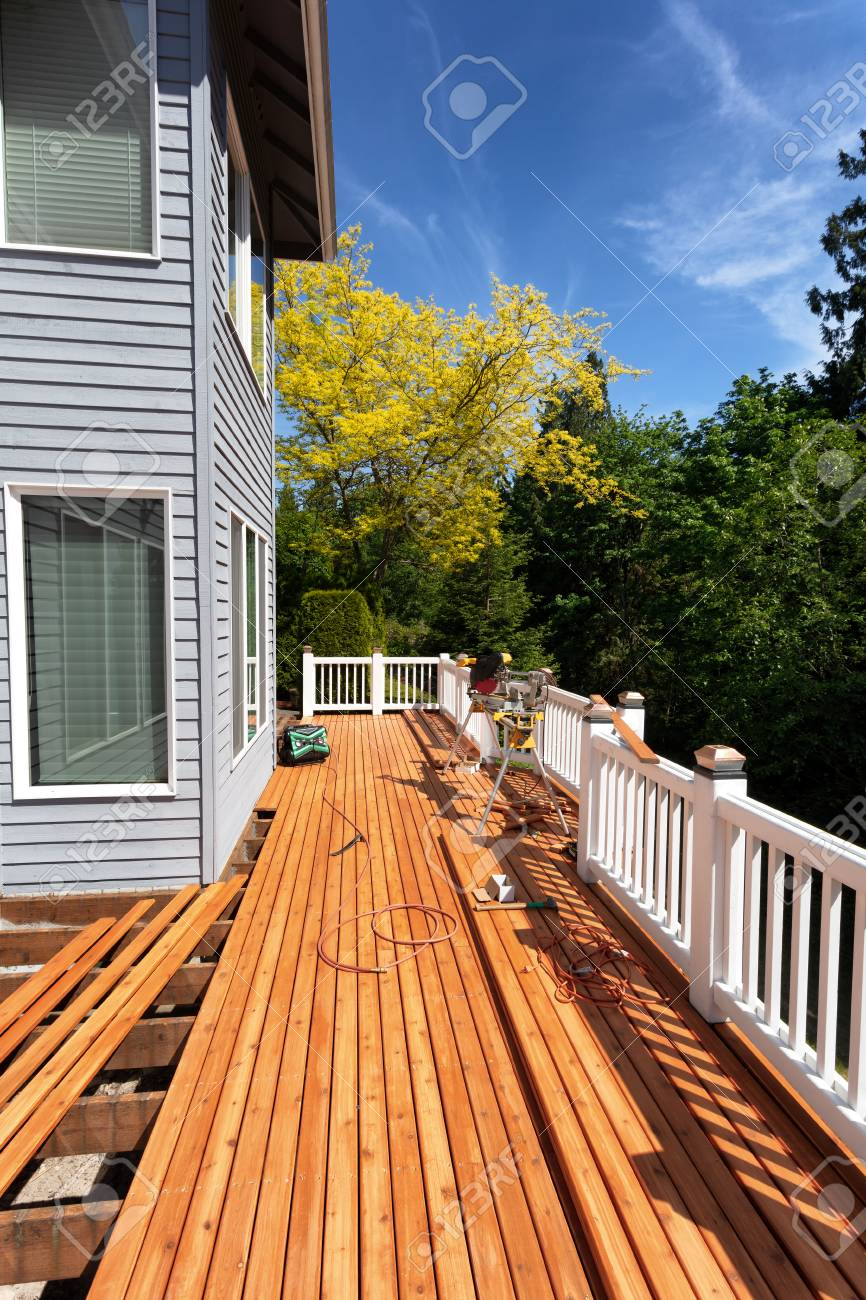 Outdoor wooden deck being completely remodeled during springtime season - 125214779