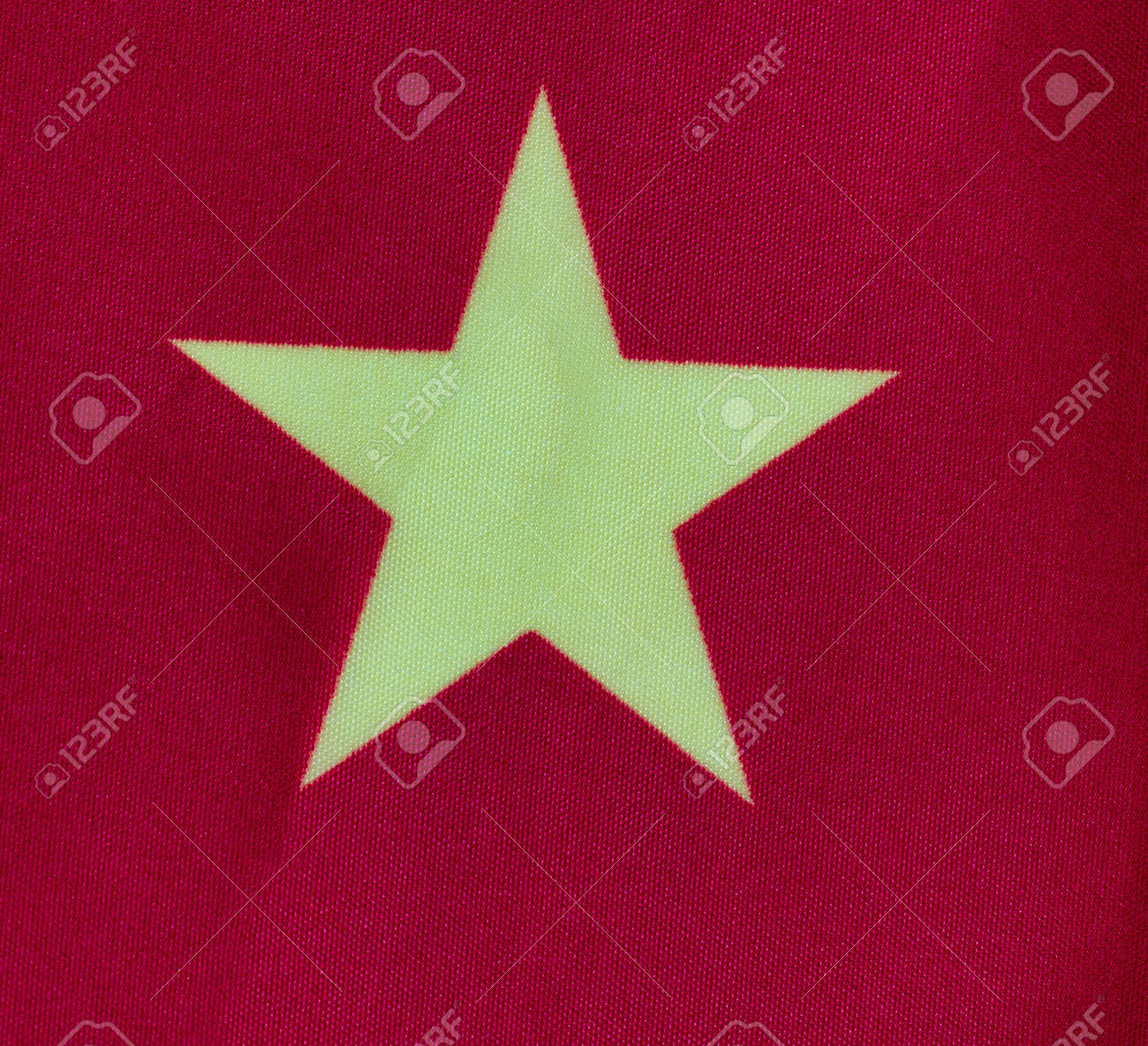 Single yellow star on red cloth background for national China symbol in close up format - 167189194