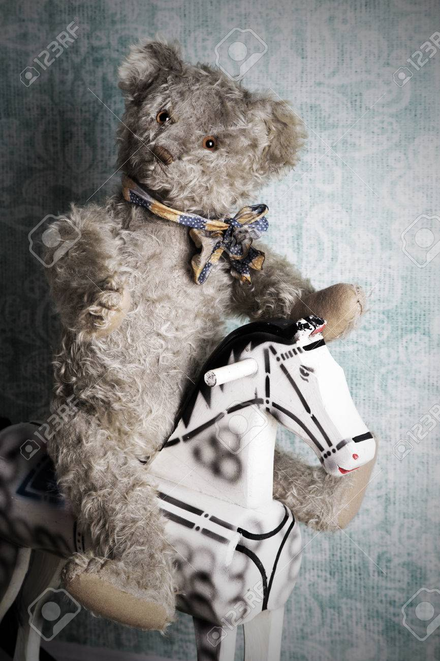 Unsightly Vintage Teddy Bear Riding An Old Wooden Rocking Horse Stock Photo Picture And Royalty Free Image Image 40827617
