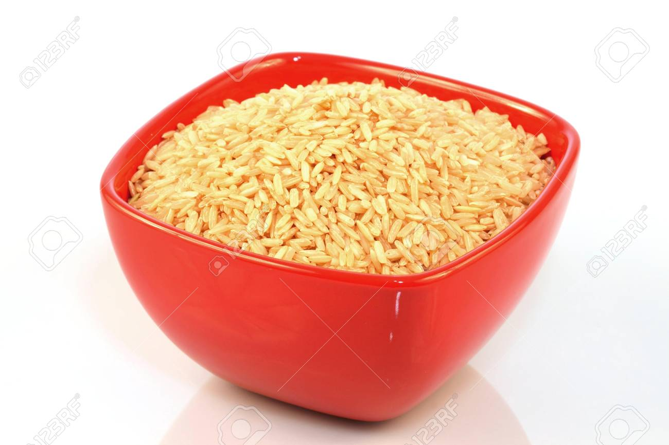 Healthy ,brown rice on white background served in a red bowl Stock Photo - 6759678