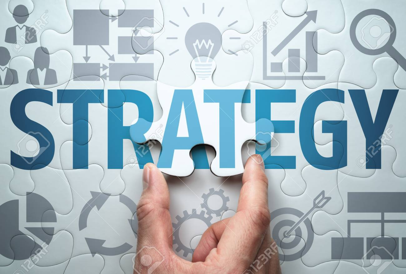 Developing business strategy. Finding solution.Connecting last jigsaw puzzle piece. - 124806811
