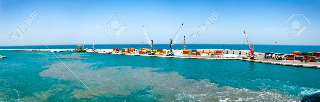 Cargo port with many containers. Big cargo harbor,with a few cranes and ships in the port. - 125665229