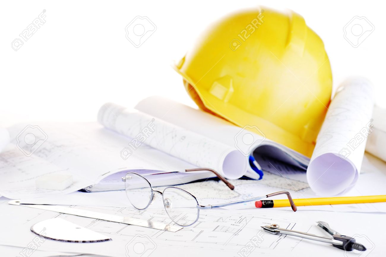 Yellow helmet and heap of project drawings Stock Photo - 6956751