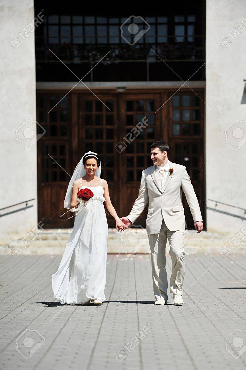 Newly wed couple  go on sidewalk for church Stock Photo - 7683202