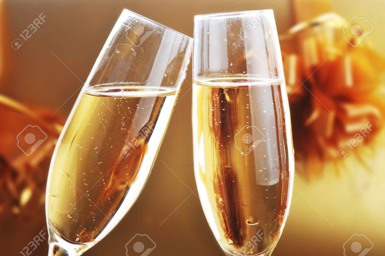 two shampagne glasses on celebratory table Stock Photo - 7756248