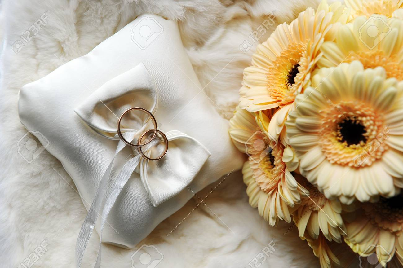 Bride Bouquet Of Yellow Flowers And Cushion With Wedding Gold ...