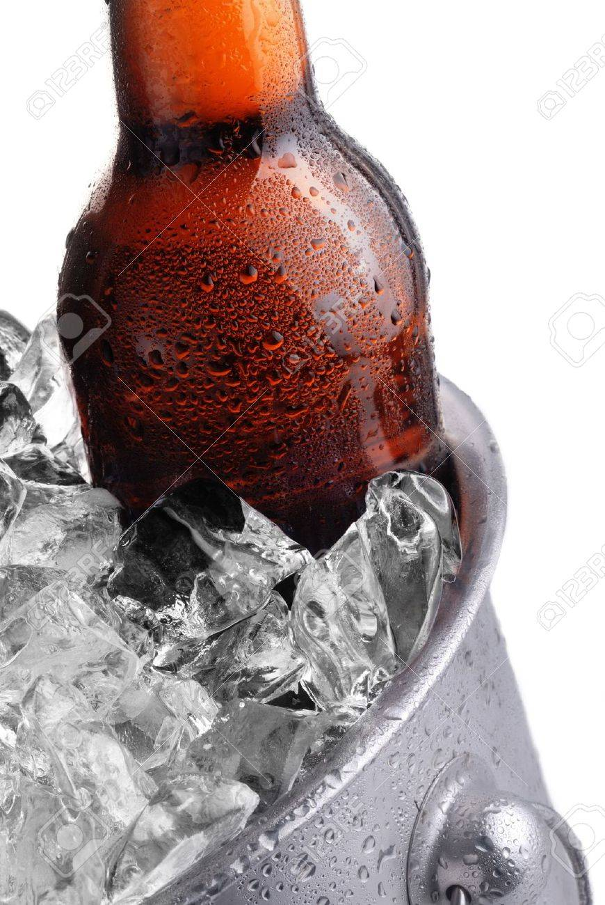 brown beer bottle in ice bucket with condensation Stock Photo - 15135919