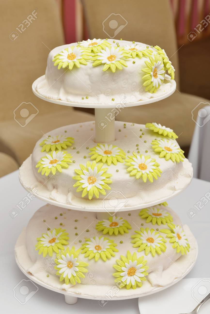 Wedding Cake With White Frosting And Flowers Of Cream Stock Photo