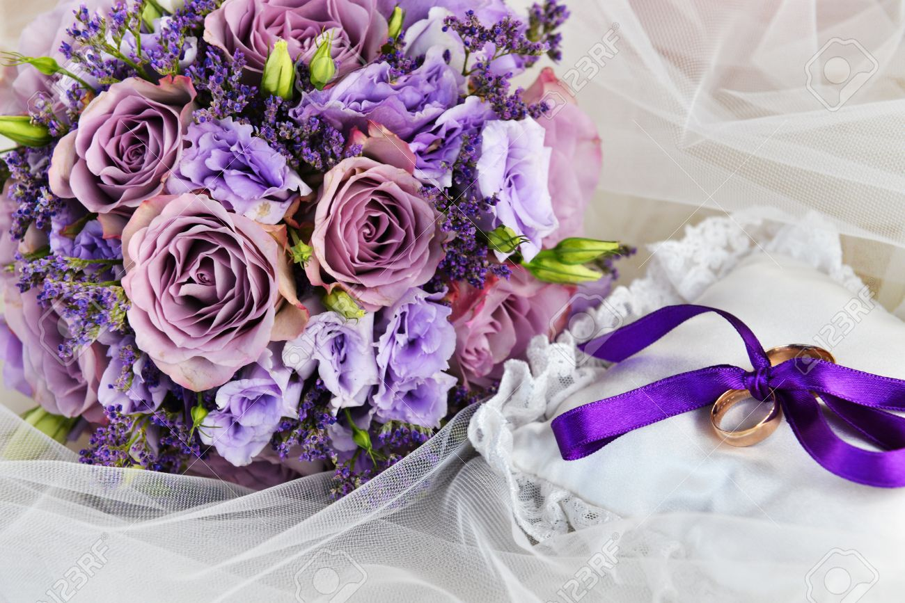 Bride Bouquet Of Purple Flowers And Cushion With Wedding Gold ...