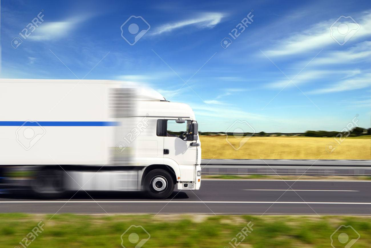 truck with freight moving fast - 24992376