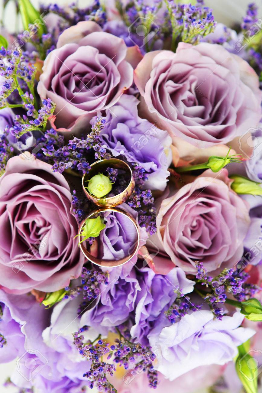 Bride Bouquet Of Purple Flowers With Wedding Gold Rings Stock Photo ...