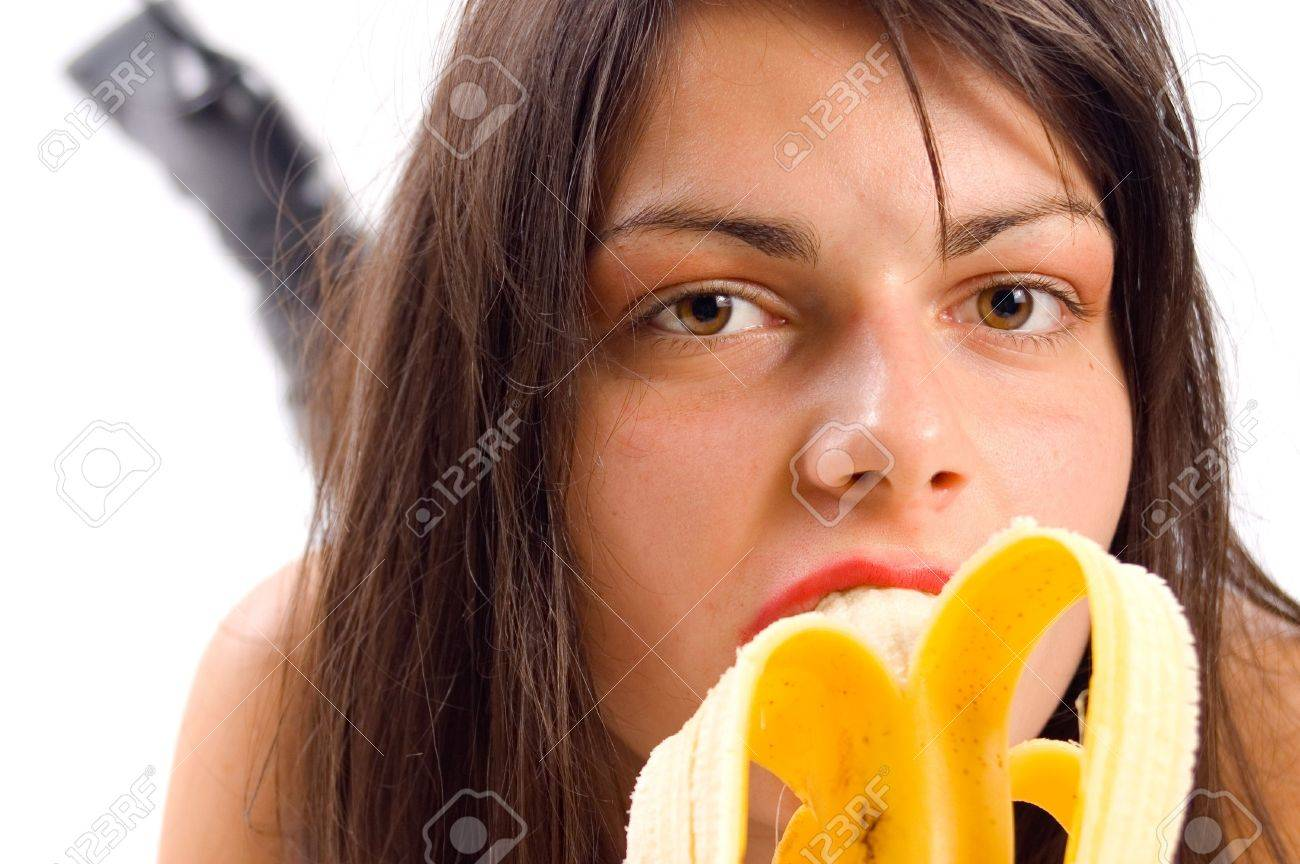 girls eating bannana Stock Photo - Young girl eating banana and enyoing with it
