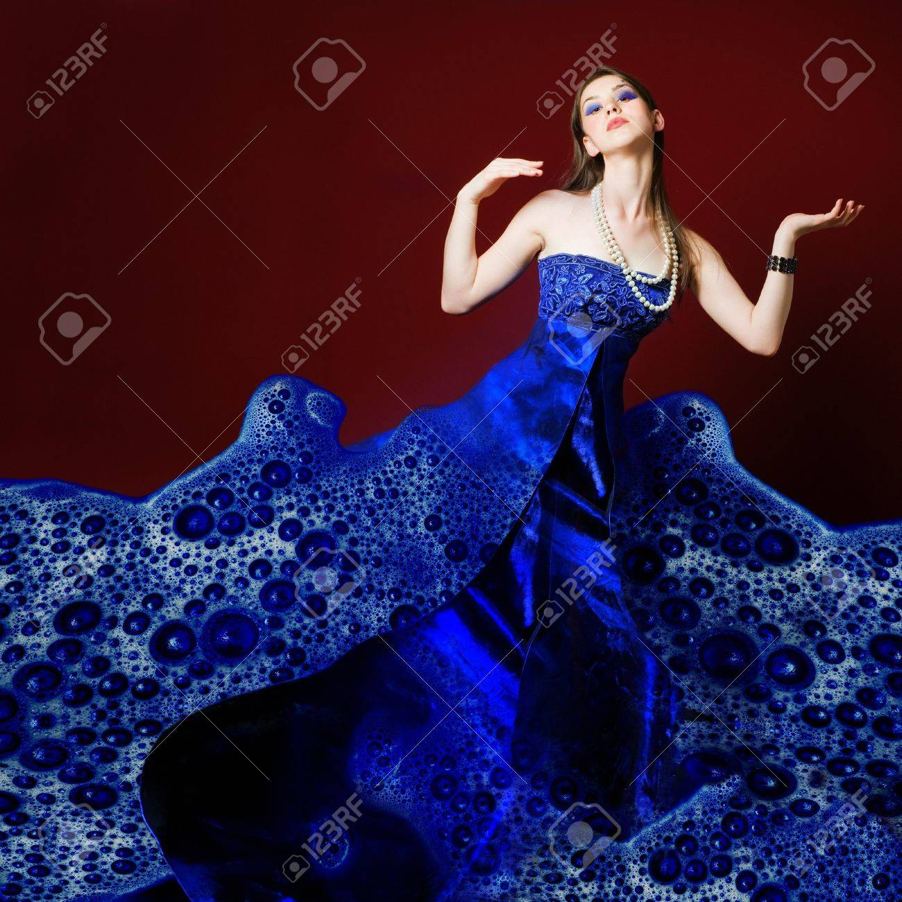 Woman dressed in blue soap bubble evening garment, grain added Stock Photo - 8258306