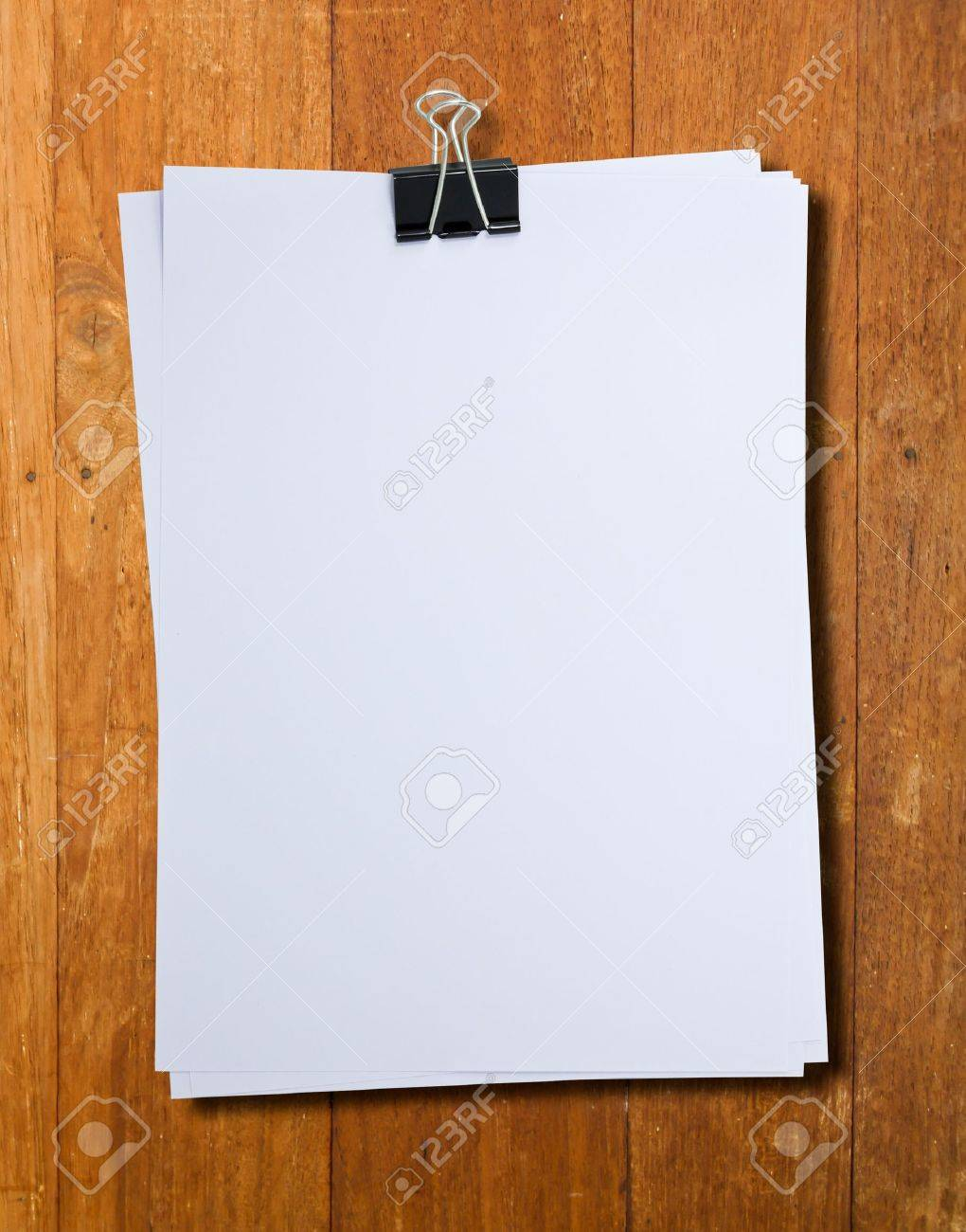 binder clip and stack of paper stock photo, picture and royalty free