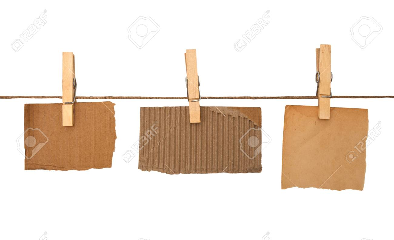 close up of a notes and a clothes pegs on white background Stock Photo - 12941544