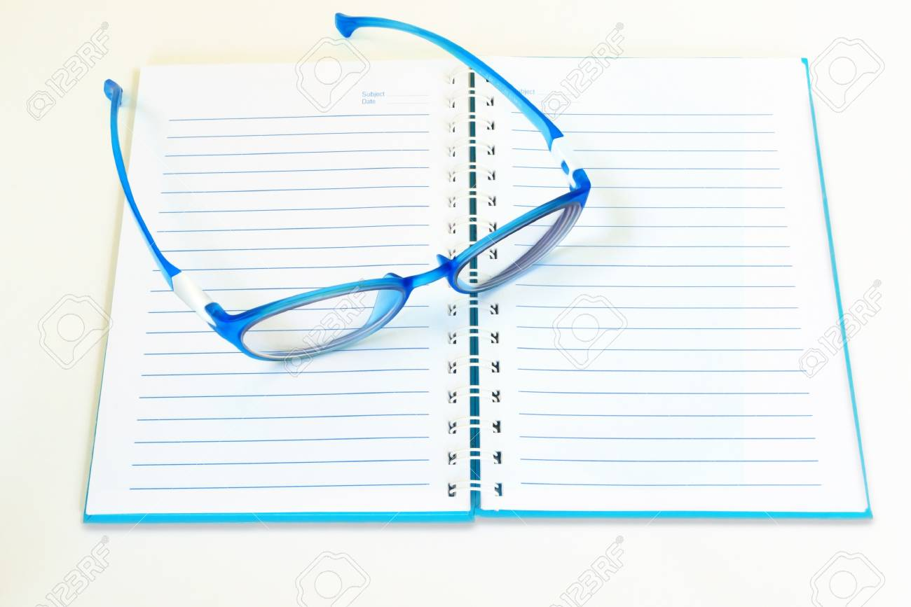 Eye glasses with  binder notebook isolated on white background. Stock Photo - 19792835