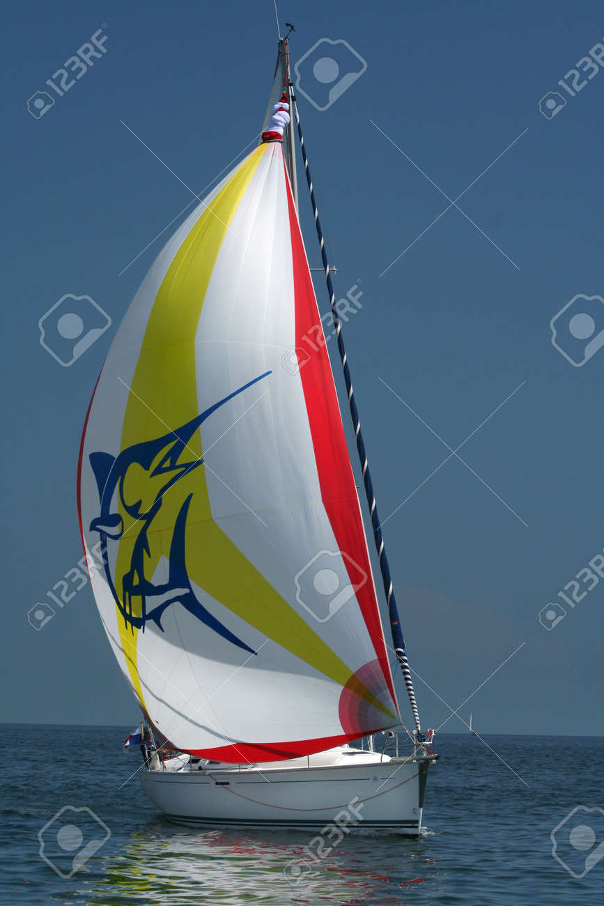 White sail in the blue sea. Calmness and rest. Stock Photo - 474017