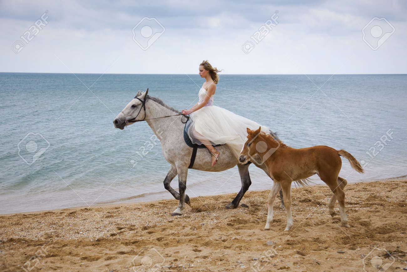 Bride and horses on the beach stock photo picture and royalty bride and horses on the beach stock photo 5103931 sciox Images