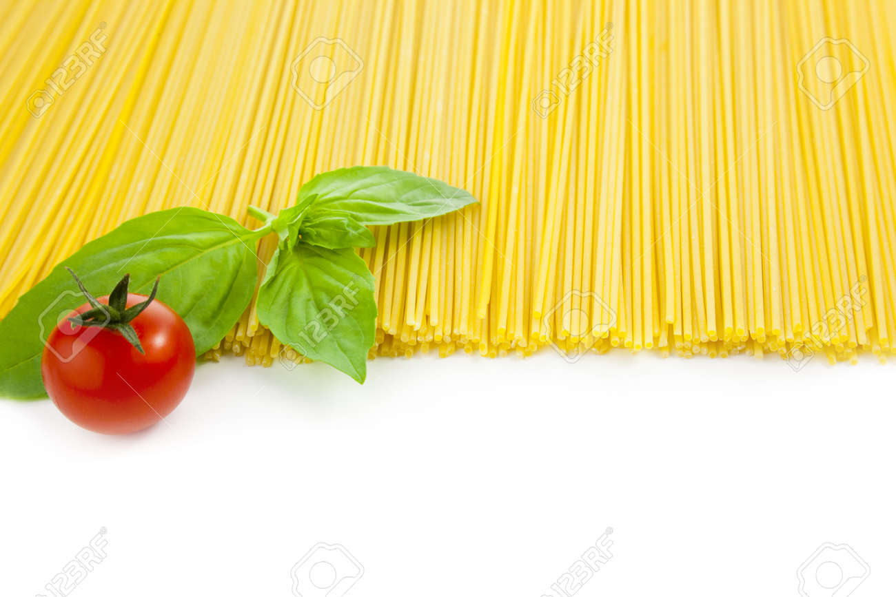 Italian cooking /spaghetti with tomatoes and basil / isolated on white Stock Photo - 9925709