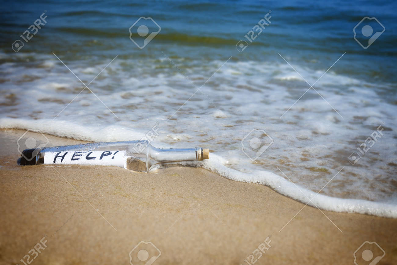 Message in a bottle / Help! / deserted beach Stock Photo - 9925770