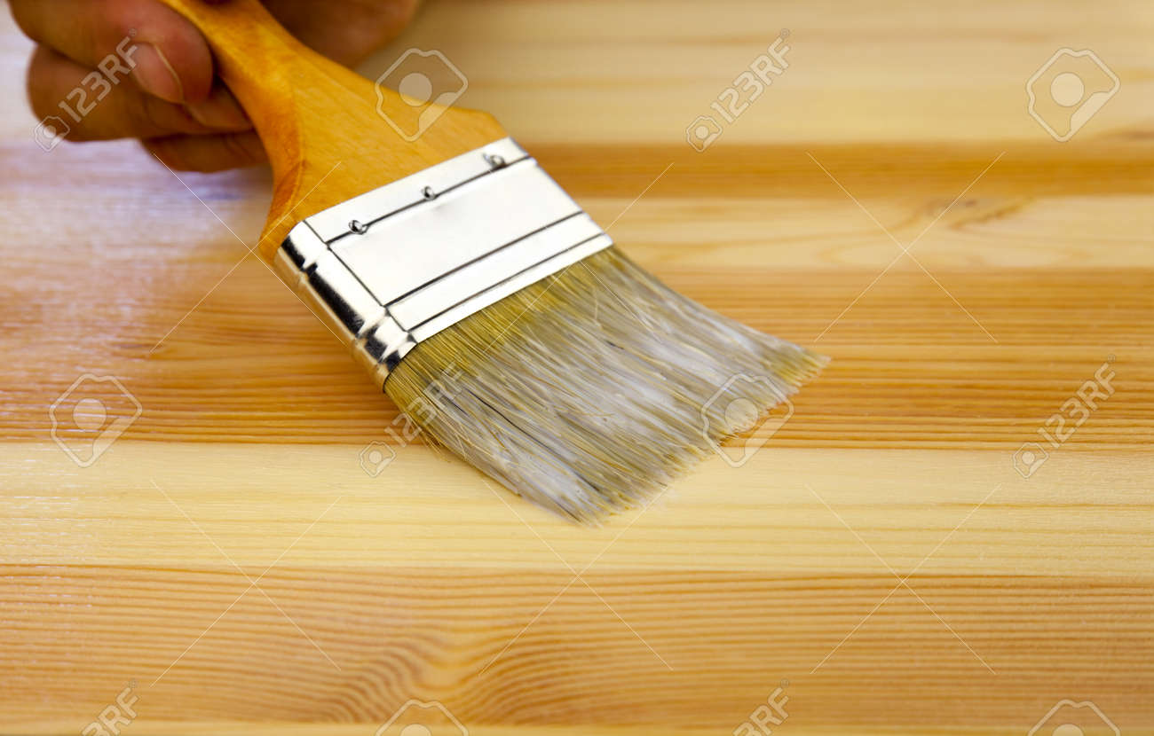 Wood texture, human hand and paintbrush / housework background Stock Photo - 10030893