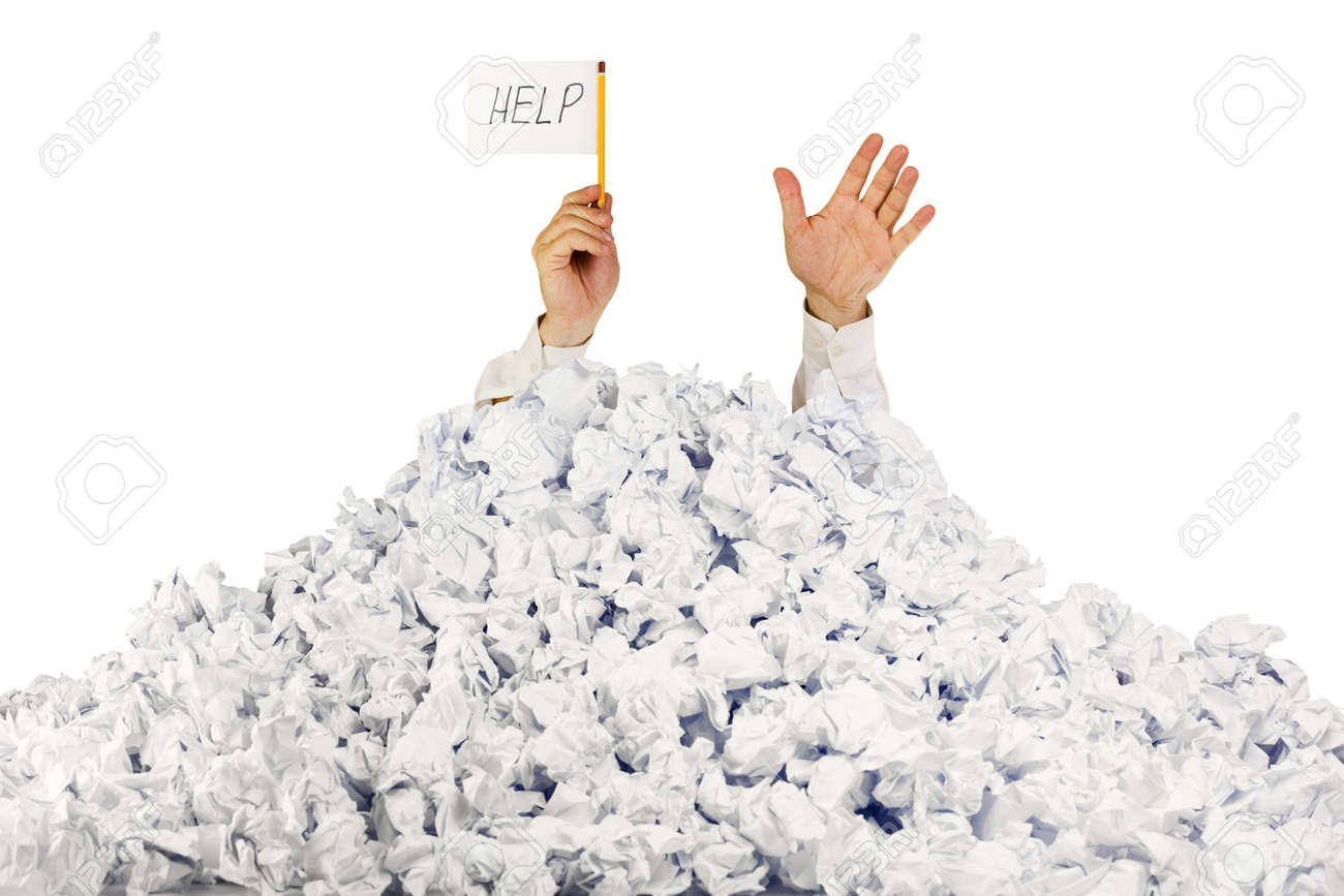 person under crumpled pile of papers hand holding a help person under crumpled pile of papers hand holding a help sign isolated on white