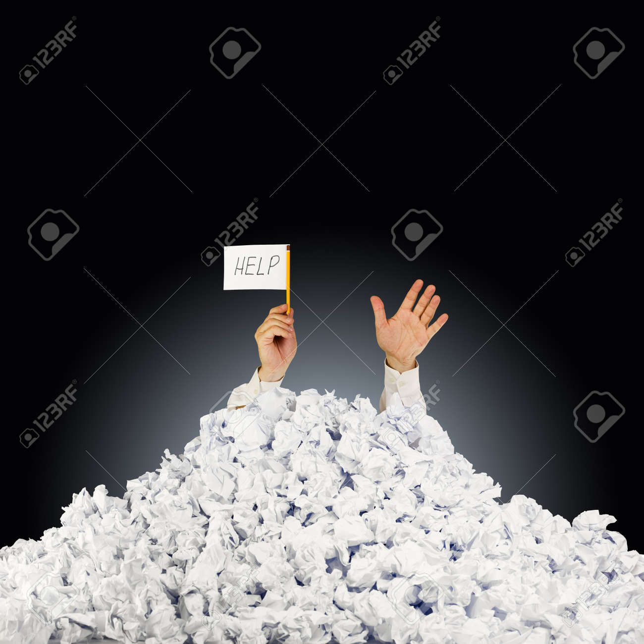 person under crumpled pile of papers hand holding a help person under crumpled pile of papers hand holding a help sign stock photo 13756182