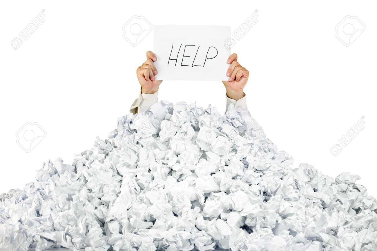 Person under crumpled pile of papers with hand holding a help sign / isolated on white Stock Photo - 13756161