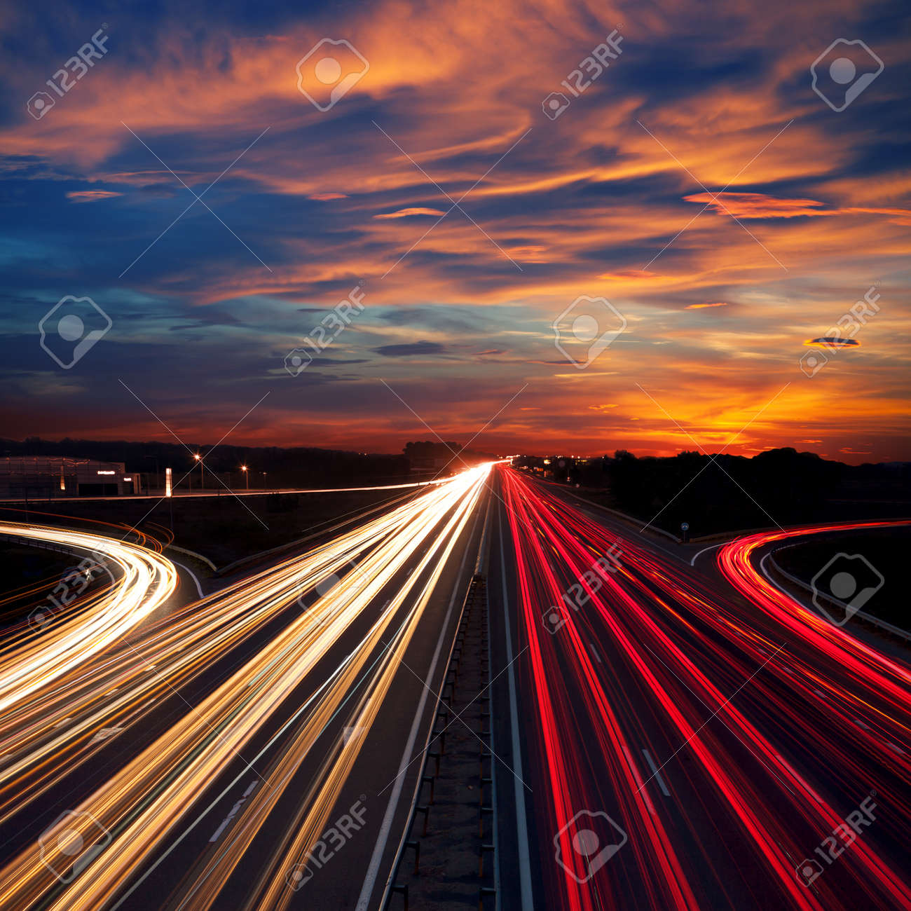 Speed Traffic at Dramatic Sundown Time - light trails on motorway highway at night, long exposure abstract urban background - 32283582
