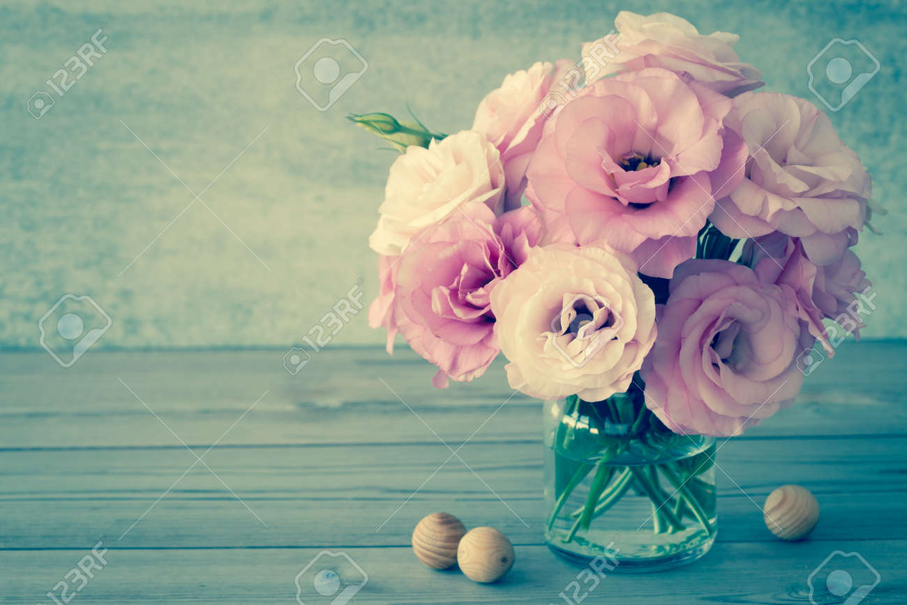 Gentle Flowers in a glass vase with copy space - vintage style still life, toned - 38906098