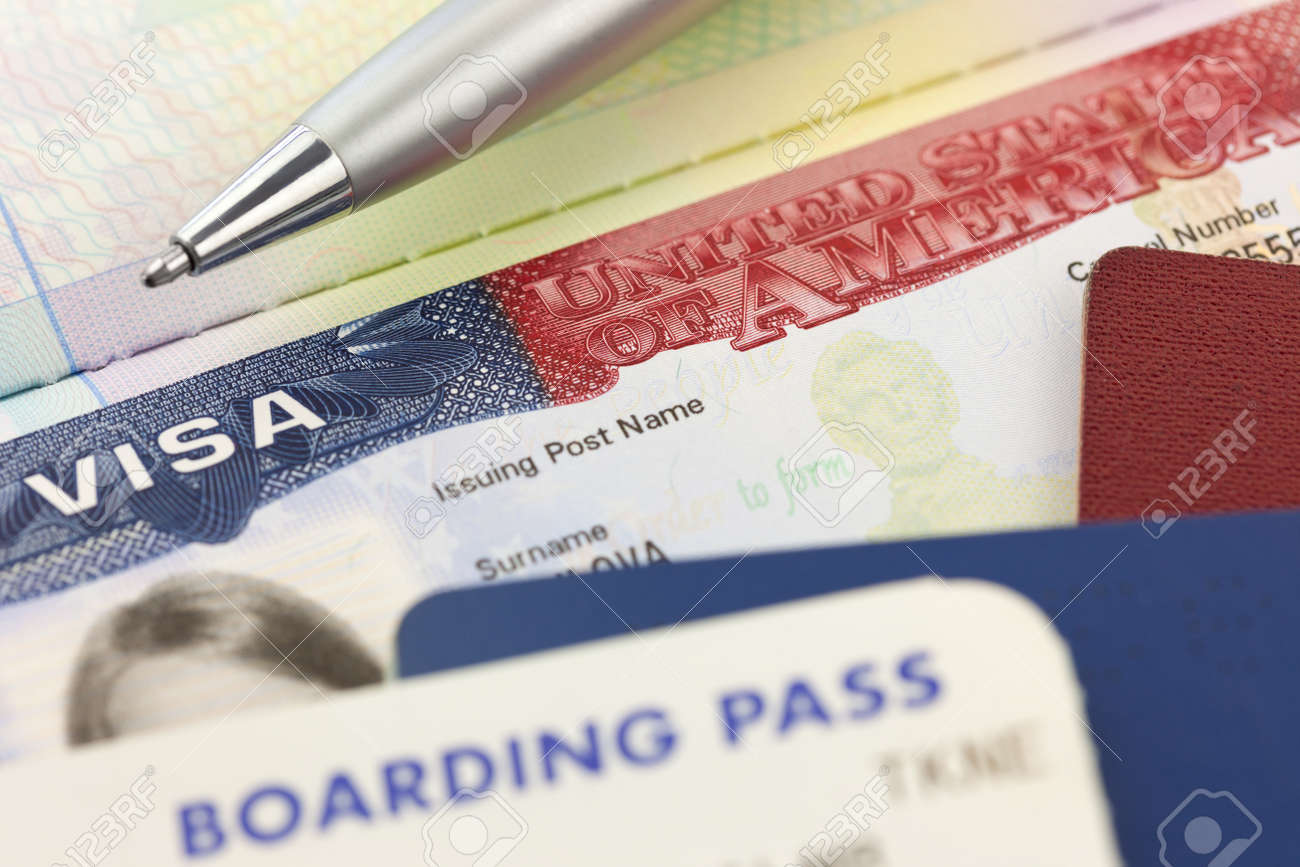 USA Visa, passports, boarding pass and pen - foreign travel background - 39326633