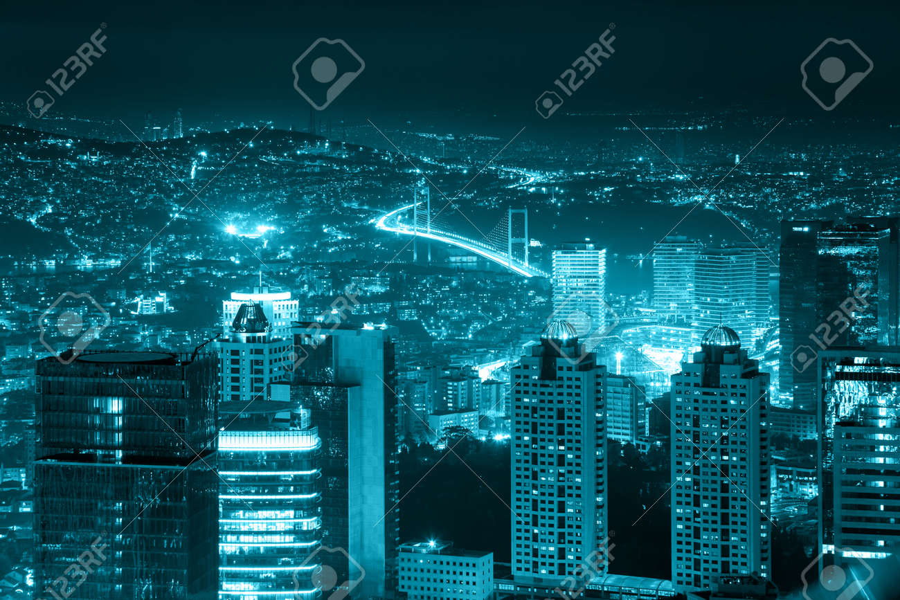 Night view of the illuminated city downtown, skyscrapers and bridge, blue toned, Istanbul, Turkey, Europe - Asia - 46324211