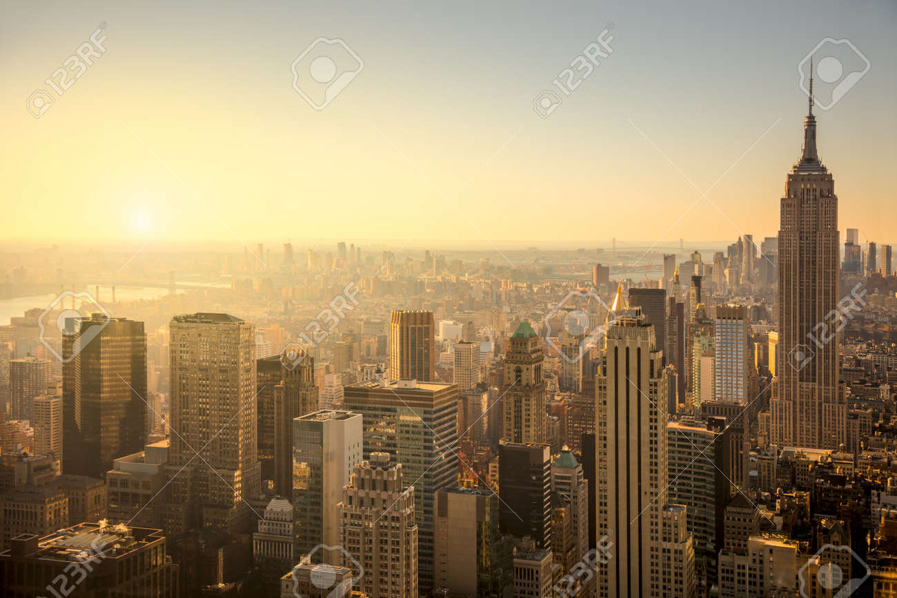 New York City skyline with urban skyscrapers at gentle sunrise, famous Manhattan view, USA - 50960925