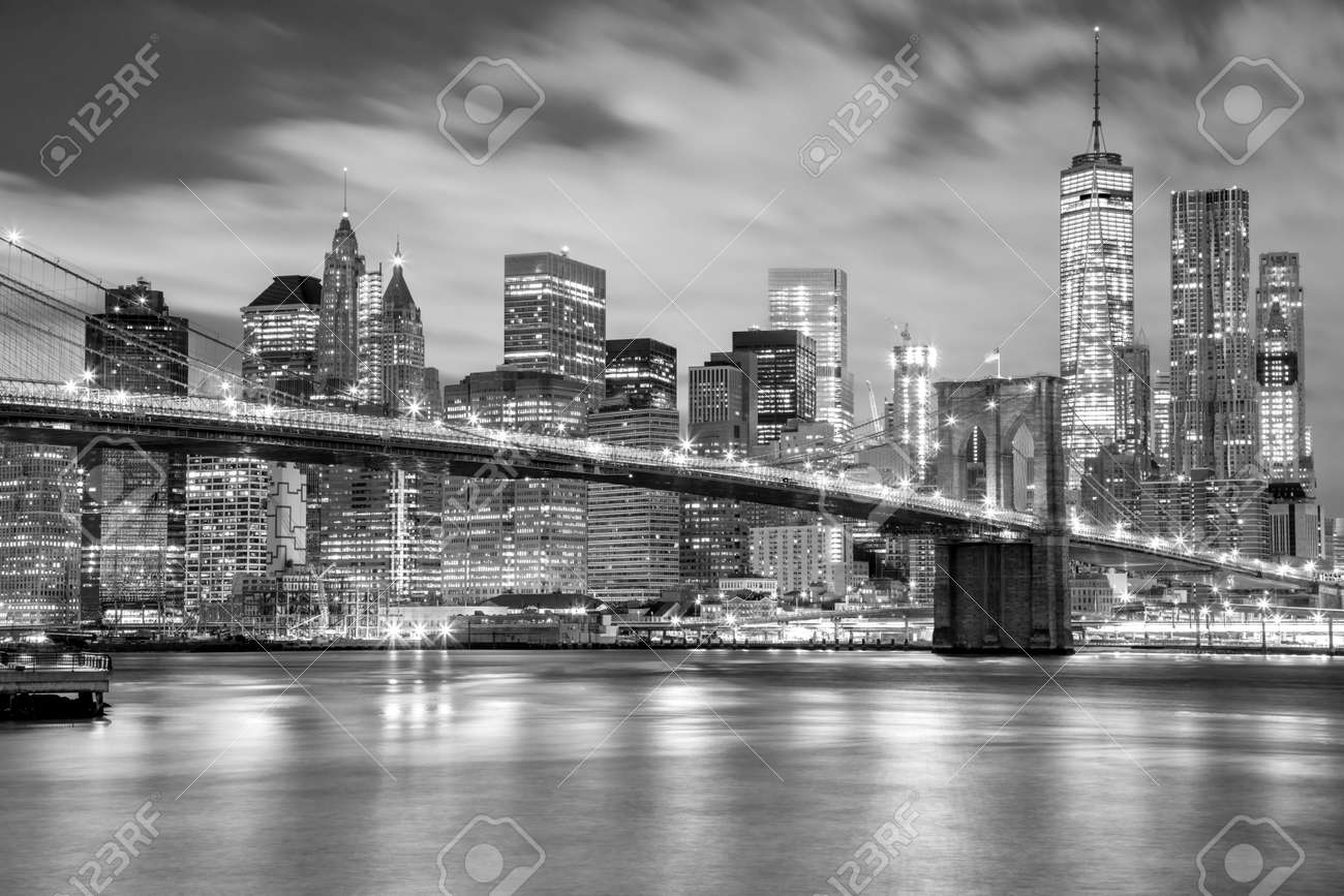 Manhattan skyscrapers and Brooklyn Bridge - city illuminations, black and white colors, New York, USA - 51352936