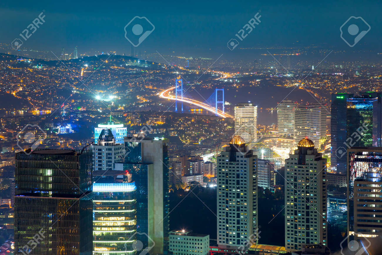 Night Aerial view of the illuminated city downtown, skyscrapers and bridge, Istanbul, Turkey, Europe - Asia - 51921992