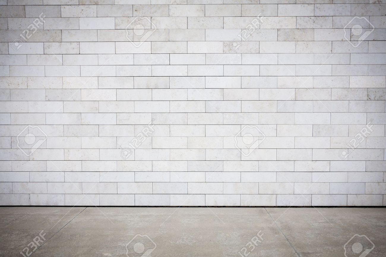 Tiled wall with a blank white Empty Brick Wall