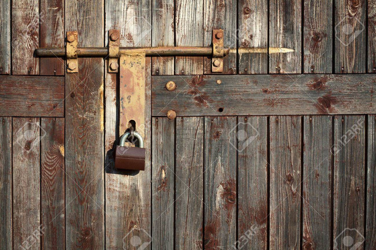 Old latch with padlock on doors Stock Photo - 11268418