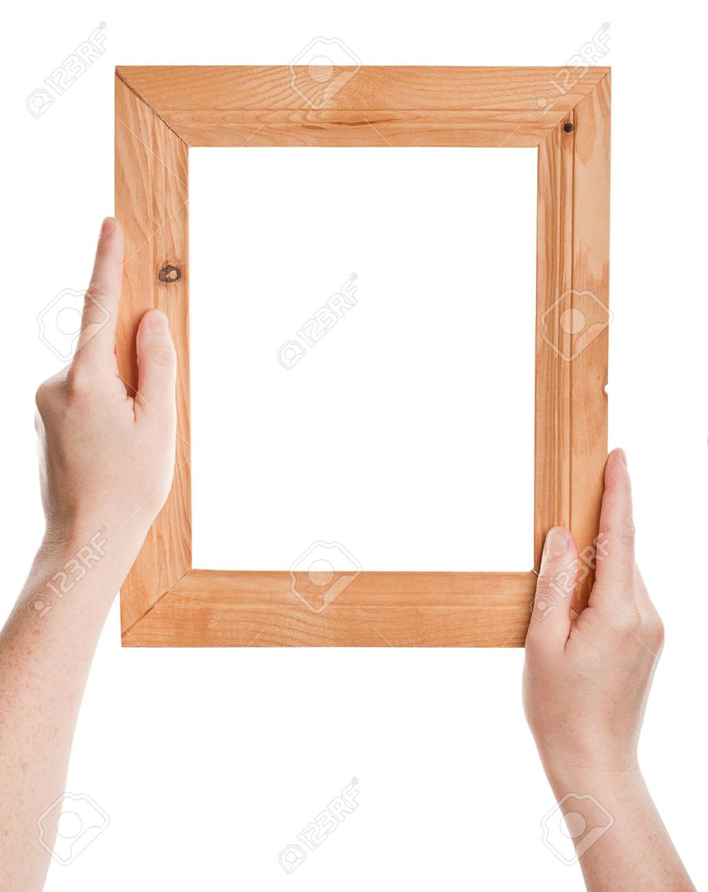 Wooden frame in hands isolated on white background Stock Photo - 13908809