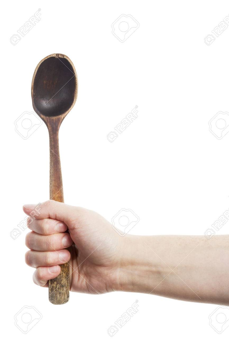 24355262-Hand-holding-old-wooden-spoon-isolated-on-white-Stock-Photo.jpg