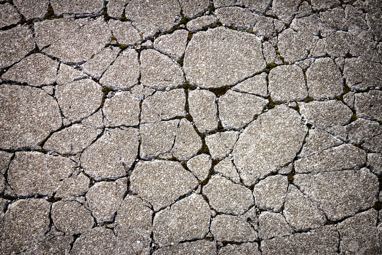 Cracked Concrete Floor Texture. Texture Of Concrete In Grey Tone With Cracked Surface And Dirt