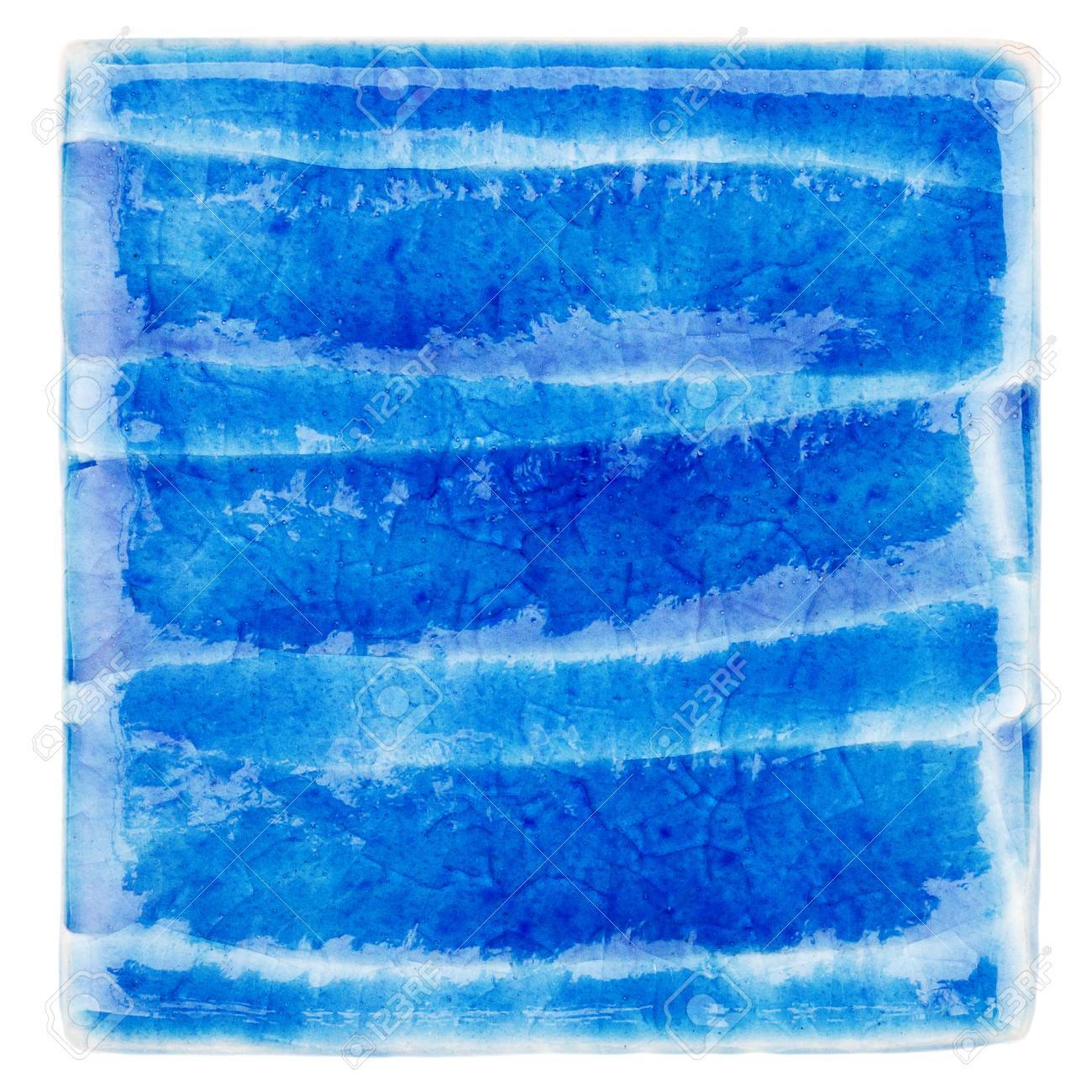 Blue lined handmade glazed ceramic tile isolated on white background blue lined handmade glazed ceramic tile isolated on white background stock photo 73234822 dailygadgetfo Choice Image