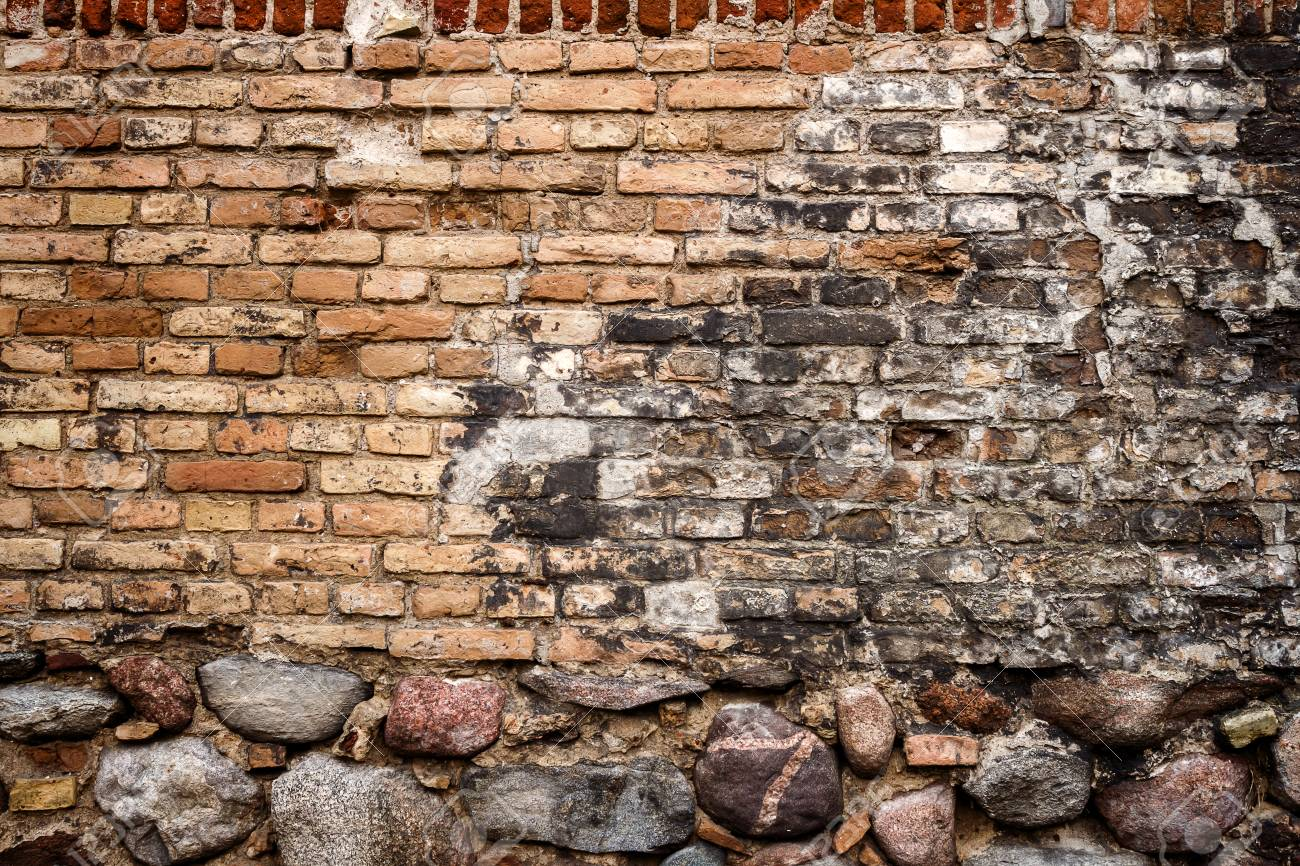 Stock Photo - Yellow brick wall background with stone basement & Yellow Brick Wall Background With Stone Basement Stock Photo ...