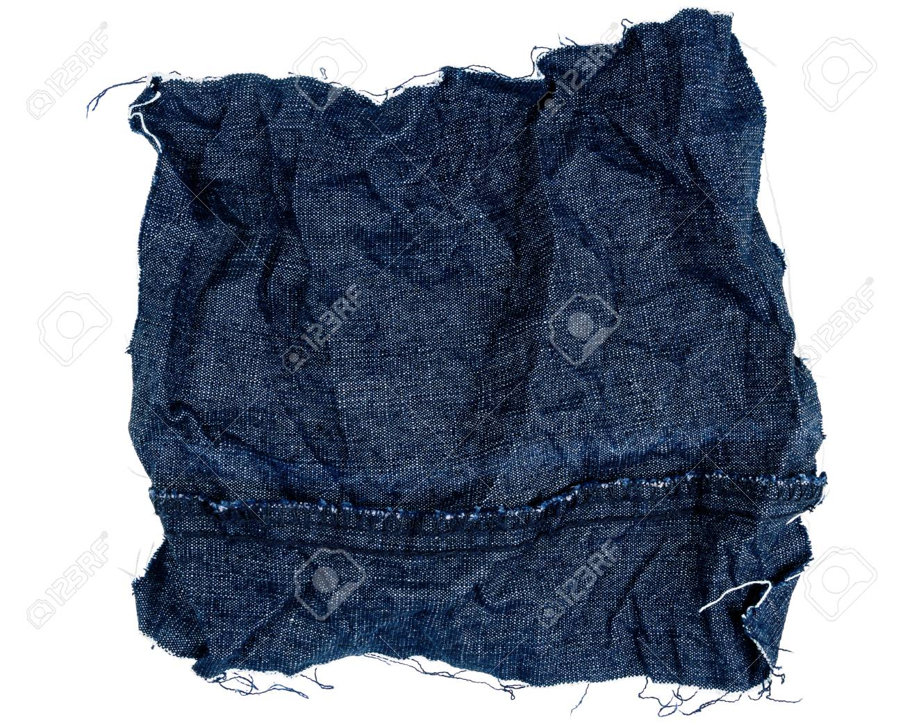 69f920f60 Piece of crumpled blue jeans fabric isolated on white background...