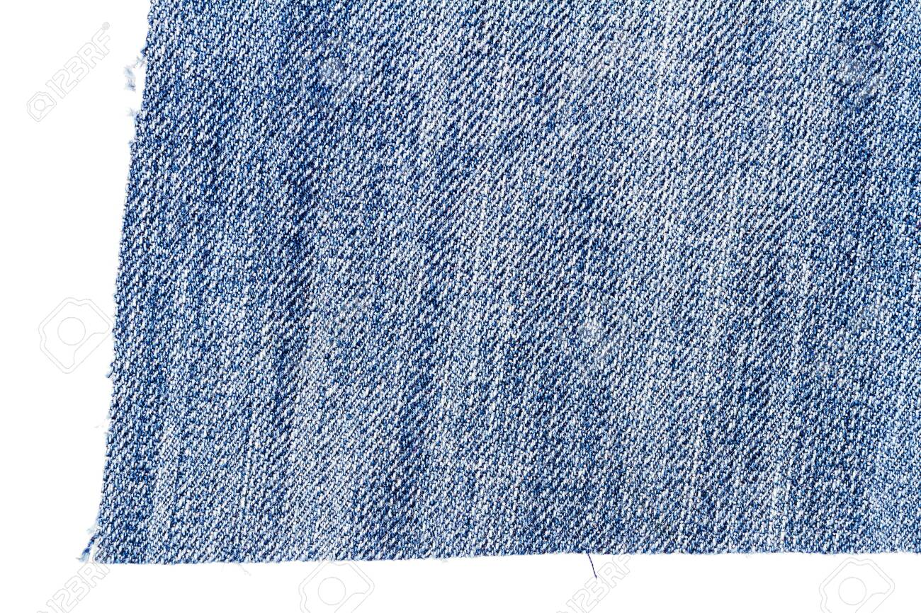 Piece of light blue jeans fabric isolated on white background. Rough uneven edges. - 123836221