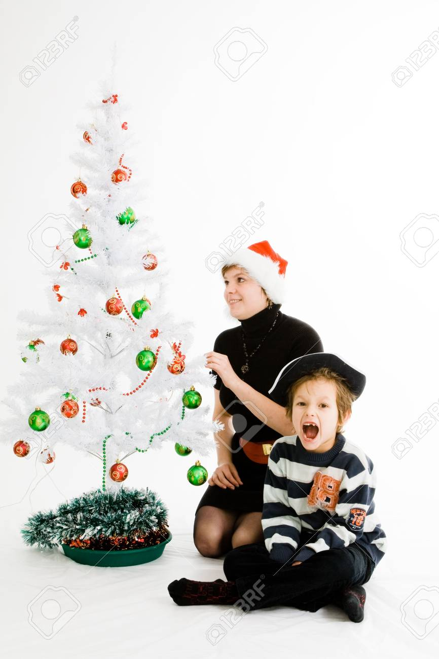 Son and mother sitting near Christmas tree Stock Photo - 6193286