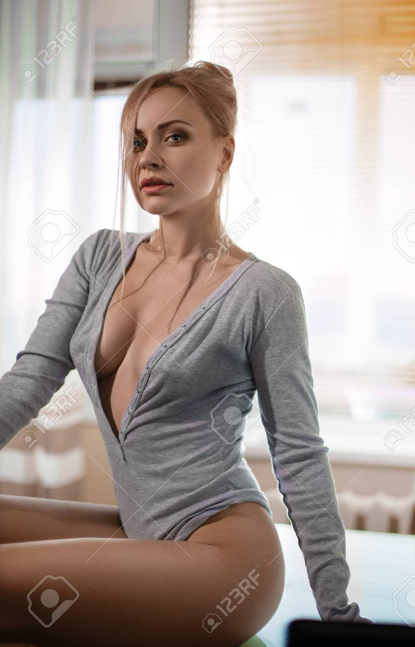 Beautiful Sexy Blonde Woman Posing On The Table In The Rays Of Stock Photo Picture And Royalty Free Image Image 144020039