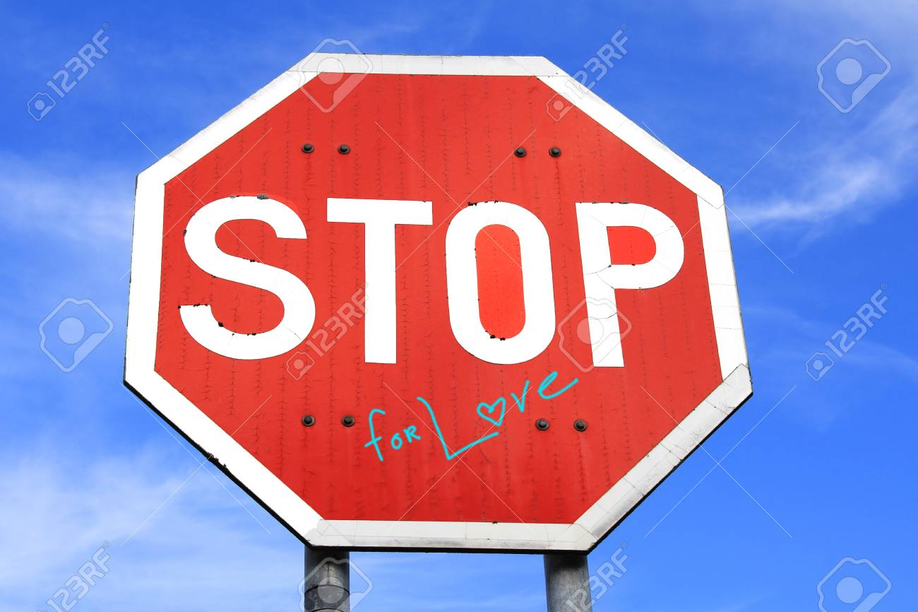 Stop For Love traffic sign against blue sky with some clouds. Text design added by photographer in post production. Stock Photo - 15315192